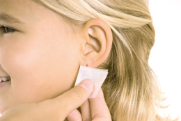 Cleansing the ear with an alcohol prep pad